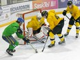 The Melfort Mustangs (in green) and the Nipawin Hawks started a late pre-season with a game in Nipawin on Friday, Oct. 23 and the following night in Melfort. Nipawin won the first game in OT 3-2 aand Melfort took the second win 2-1. Photo Susan McNeil.