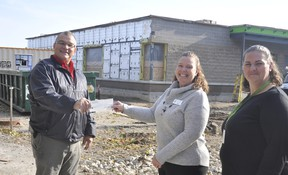 Steve Walkom (left), of Walkom's valumart recently donated $1,162 through their recent two-week Give A Little Help A Lot campaign to Perth Care For Kids' child care co-ordinators Pam Shewan and Candice Kochut (right) in front of the under-construction facility. The funds will be used to augment the opening of the child care facility, perhaps with an outdoor play area, once it officially opens in early 2021. ANDY BADER/MITCHELL ADVOCATE