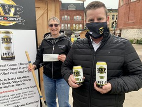 Tyler MacIntosh, co-owner of MVP Brewing, donated a cheque for $200 to Jane Larkworthy of the local Special Olympics chapter. The local brewery is donating five per cent of its sales to sports organizations. (Cory Smith/The Beacon Herald)