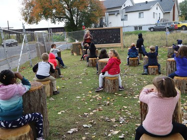 Meredith Coulas and her French immersion students show off an outdoor classroom at Lansdowne Public School in Sudbury, Ont. on Thursday October 1, 2020. The schoolyard at Lansdowne is being used as an alternate place of learning for students as part of a revitalization plan at the school, and because of the COVID-19 pandemic. John Lappa/Sudbury Star/Postmedia Network