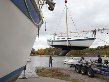 A crane was used to lift a sailboat out of Ramsey Lake at the Sudbury Yacht Club in Sudbury, Ont. on Friday October 2, 2020. The crane was used to remove all the boats from the water to wrap-up the sailing season. John Lappa/Sudbury Star/Postmedia Network