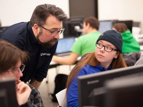 Professor Aaron Langille works with students during a class at Laurentian. Supplied