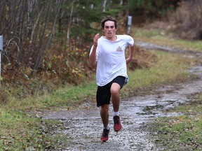 Kyle Gouchie, of Bishop Alexander Carter Catholic Secondary School, competes in a five kilometre run at the Naughton trails in Naughton, Ont. on Wednesday October 21, 2020. John Lappa/Sudbury Star/Postmedia Network