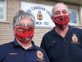 Dianne Hodges, left, president of the Royal Canadian Legion Branch 153 in Tillsonburg, and Don Burton, local poppy campaign chair, model the Legion fask masks, which are being sold as a fundraiser to support the local Legion. (Chris Abbott/Norfolk and Tillsonburg News)