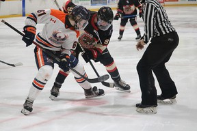 Photo courtesy NOJHL.com  Soo Thunderbirds centre Cooper Smyl (left) battles for the puck with Blind River's Lucas Adams in NOJHL exhibition action on Saturday at Blind River Community Centre.
