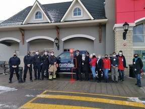 High River firefighters, Salvation Army members, and staff from High River Co-op, all gathered in front of Co-op on Nov. 14 to kick off the 2020 Foothills Salvation Army's Kettle Campaign.