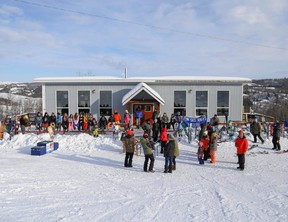 Participants in the Fairview Ski Hill Family Day fun competition lined up out side the chalet last winter, waiting to hear who the winners were.