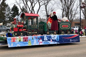 Mayor Gale Katchur and the City mascot pictured during the 2019 Santa Claus Parade. The annual parade has been replaced by a Light Walk this year to accomodate COVID-19 safety protocols. Photo Supplied by the Fort Saskatchewan and District Chamber of Commerce.