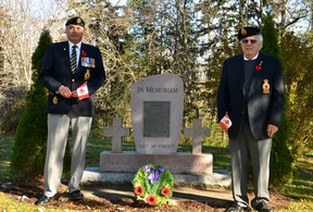 The Town of St. Marys is honouring local veterans and soldiers who gave their lives to protect their countries during two pandemic-friendly events -- the town's annual Veterans' Decoration Day at the St. Marys Cemetery this Saturday and a Remembrance Day ceremony at Town Hall on Nov. 11 that will be broadcast live on Facebook. Pictured, St. Marys Legion president Tom Jenkins and Poppy Campaign chair Owen Merchant stand at the Veterans' Memorial at the St. Marys Cemetery. Galen Simmons/The Beacon Herald/Postmedia Network
