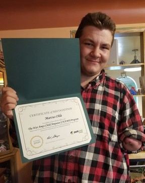Marcus Ohle with his certificate of recognition from Parkland County Mayor Rod Shaigec.