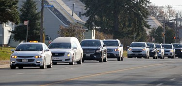 Funeral procession of the late Carmen Marrelli approaches Canadian Motor Hotel on Pim Street in Sault Ste. Marie, Ont., on Thursday, Nov. 5, 2020. (BRIAN KELLY/THE SAULT STAR/POSTMEDIA NETWORK)