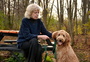 New Hamburg author Nancy Silcox and her golden doodle Rose pose for a photo at the Stratford Dog Park Friday afternoon, just days before Silcox is set to receive the first copy of the second volume of her book series, Workin' Like a Dog; Doin' Nuthin' Like a Cat: Canadian Pets who go to the Office. Galen Simmons/The Beacon Herald/Postmedia Network
