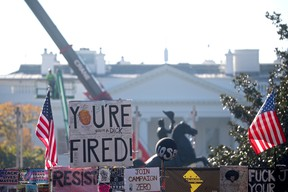"""A """"You're Fired"""" sign hangs atop a fence in front of the White House, days after former Vice President Joe Biden was declared the winner of the 2020 U.S. presidential election, in Washington, DC, U.S., November 9, 2020. REUTERS/Hannah McKay"""