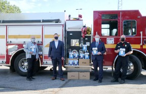Tillsonburg District Real Estate Board and their community sponsors presented 67 carbon monoxide alarms to Tillsonburg Fire and Rescue Services Monday morning - with a few more still coming. From left are Walter Kleer and Marcel Vandehoef, from the TDREB Community Programs Committee, Oxford MPP Ernie Hardeman, and Tillsonburg Fire Chief Brad Lemaich. (Chris Abbott/Norfolk and Tillsonburg News)
