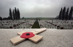 A poppy is left on a memorial  in the Tyne Cot Cemetery, the largest Commonwealth war grave cemetery in the world, near Ypres, Belguim. The Commonwealth War Grave Commission manages 956 cemeteries in Belguim and France, which bear witness to the heavy human sacrifice made on the Western Front during the First World War (1914-1918) and Second World War (1939-1945). Photo by Matt Cardy/Getty Images