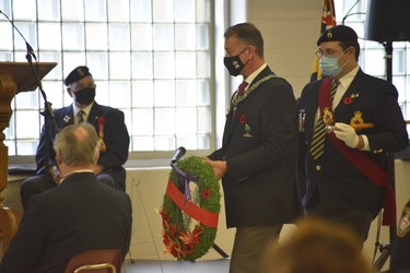 Woodstock mayor Trevor Birtch was among a small group to lay wreathes on Wednesday, as did MPP Ernie Hardeman and MP Dave MacKenzie. The elected officials also gave remarks as part of the scaled-down ceremony. (Kathleen Saylors/Woodstock Sentinel-Review)