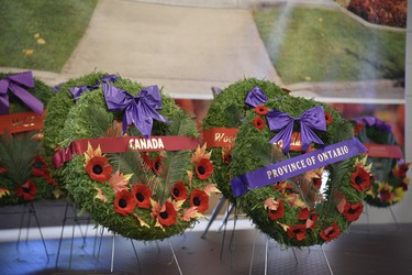 While dozens of wreathes are usually laid, this year 10 representatives laid wreathes on behalf of other groups at a ceremony at Goff Hall held by invitation-only to control crowd sizes. (Kathleen Saylors/Woodstock Sentinel-Review)