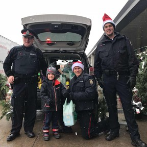 In the midst of pandemic, the Stratford Police Service announced it will carry forward with its annual toy and food drives in Stratford and St. Marys this holiday season. Pictured are members of the Stratford Police Service during its Stuff-a-Cruiser toy drive event last year. Submitted photo