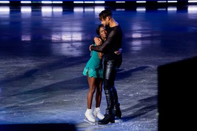 Former Sudbury Wolves player and NHLer Akim Aliu embraces with his Battle of the Blades partner, champion figure skater Vanessa James, after learning they will move on in the competition, on Thursday, November 12, 2020.
