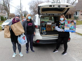 Mindy Bowls (left), Myrna Panjer and Julia Snelgrove, 13, were busy collecting donations of food and toys during The Gift CK event held across Chatham-Kent on Nov. 21. Ellwood Shreve/Postmedia Network