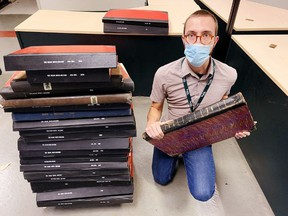 County archivist Joshua Klar with bound volumes of The Simcoe Reformer and The Delhi News-Record that were recently donated to the Norfolk County Archives in downtown Simcoe. Monte Sonnenberg/Postmedia Network