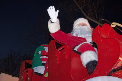Santa Claus waves to passing vehicles from his sleigh during the annual Parade of Lights in Stratford on Sunday. Chris Montanini\Stratford Beacon Herald