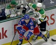 London Knights Max McCue hits Kitchener Rangers Michael Vukojevic behind the Rangers net in London, Ont. on Saturday December 28, 2019.