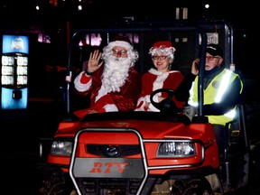 Having arrived early by sleigh from the North Pole, Santa and Mrs. Claus left Blockhouse Island briefly for some refreshments and were driven back by Rotarian Ed Coon, co-chairman of the organizing committee.