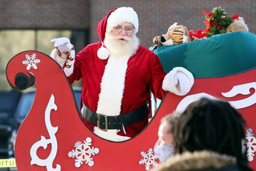 Santa Claus greets visitors at the Historic Downtown Chatham Business Improvement Area parking lot in Chatham, Ont., on Saturday, Nov. 28, 2020. He was in the BIA parking lot because the COVID-19 pandemic led to the cancellation of the annual Christmas parade. Mark Malone/Chatham Daily News/Postmedia Network