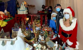 Ida Mcaulay (in foreground) with help from family and friends, has created a large Christmas village display at 31 West Street in Goderich. The display aims to bring joy and a moment of peace for visitors to the shop front leading up to Christmas. Kathleen Smith