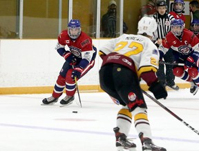 Rayside-Balfour Canadians forward Nick DeGrazia (61) carries the puck during NOJHL action against the Timmins Rock at Chelmsford Arena in Chelmsford, Ontario on Thursday, November 19, 2020.