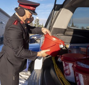 Capt. Peter Kim of the Grande Prairie Salvation Army loads a vehicle on Friday, Nov. 13, 2020.