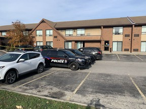 Brantford police officers guard the scene of a shooting Saturday morning November 7 at the Comfort Inn at King George Road and Wood Street on Saturday.