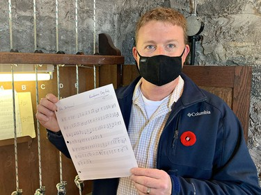 Will Fletcher, carillonneur at Grace Anglican Church shows the sheet music he transcribed to play Rule Britannia on the church bells just after 11 a.m. on Wednesday November 11, 2020 in Brantford, Ontario. Brian Thompson/Brantford Expositor/Postmedia Network