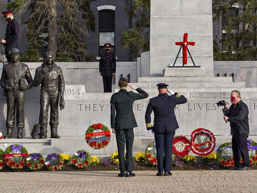 Gunner Ty Shamblin of the 56th Field Regiment and Brantford Fire Chief Todd Binkley salute after laying wreaths on Wednesday morning at the Brant County War Memorial in downtown Brantford.  Brian Thompson/Brantford Expositor/Postmedia Network