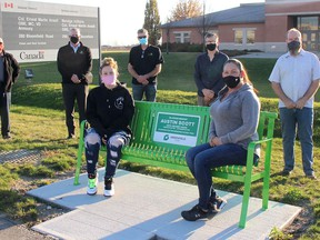 A memorial bench has been installed along the Greenfield Global Trail on Bloomfield Road in Chatham to honour the memory of Austin Scott. He died at age 18 after being struck by a vehicle while riding his bicycle on the evening of Nov. 25, 2015. In the front are sister Alissa Scott (left) and mother Jenn Scott. In the back are Angelo Ligori, senior advisor with Greenfield Global, Neil Bishop, Greenfield Global vice-president of operations, Greg Devries and Hilco Tamminga, partners in Truly Green Farms greenhouses, and Jeff Bray, manager of parks and open spaces with the Municipality of Chatham-Kent.