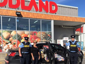 SD&G OPP Auxiliary officers and volunteers at the Ingleside location during a previous edition of the Stuff a Cruiser Food Drive. Handout/Cornwall Standard-Freeholder/Postmedia Network  Handout Not For Resale