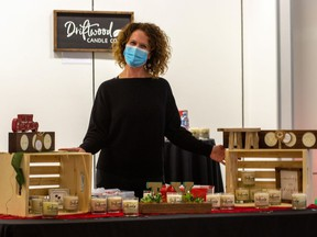Reneé Gadbois, owner of Driftwood Candle Co. at her table at the holiday market, part of a marketplace set up at the Cornwall Square on the first floor of the shopping centre.. Photo taken on Saturday November 21, 2020 in Cornwall, Ont.  John Macgillis/Special to the Cornwall Standard-Freeholder/Postmedia Network