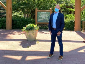 Mayor Jeff Genung stands outside the RancheHouse wearing his mask on July 29 after he and other councillors passed a face covering requirement should active cases reach 10, a figure that's been reached three months later.