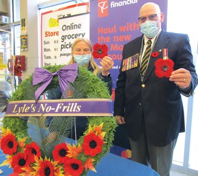 Photo by CINDY WOODS/FOR THE STANDARD Volunteer Sue Jarmovich and Royal Canadian Legion Branch 561 Poppy Chair Al Warman were set up at No Frills on Saturday, Oct. 31 to sell poppies.