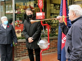 Ralph Diegel performs at the official launch of the Salvation Army Kettle Campaign, Nov. 20, 2020, alongside Maj. Bonita McGory, left, of the Salvation Army and Nipissing-Timiskaming MP Anthony Rota. Nugget File Photo