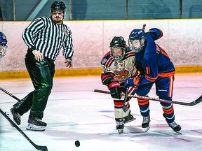 Jared Dupuis of the Blind River Beavers and Tyson Doucette of the Soo Thunderbirds chase the puck in NOJHL exhibition action from this past weekend. BOB DAVIES