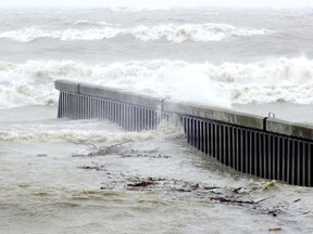Water washes over a steel groyne in Bright's Grove Oct. 30, 2012. (Observer file  photo)