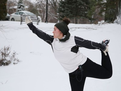 Stephanie Cotnoir cools down with yoga after a run at Bell Park in Sudbury, Ont. on Wednesday November 25, 2020. John Lappa/Sudbury Star/Postmedia Network