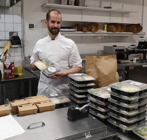 Alex Lussier, of West Coast Food Catering, puts the finishing touches on his home-cooked meals, 41 of which were donated to members of the community on Wednesday, December 30. SUBMITTED