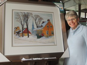 """Auxiliary member Judith Bond with the next print at the Kincardine Hospital, which is entitled """"Winter Morning Baie St. Paul"""""""