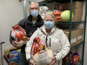 Eva and Peter Main, Church Out Serving volunteers, will be cooking up the turkeys on Christmas day to serve as part of the take-out meal program offered by the group. (CONTRIBUTED)