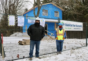 Joe Scrocco, build services director, and Lynda Henriksen, director of fund development and communications, stand outside of the Brook Street, Simcoe, Habitat for Humanity build on Thursday afternoon. (ASHLEY TAYLOR/SIMCOE REFORMER)