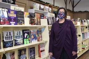 The Merrifield book Shop in downtown Woodstock is closing its doors at the end of this year, citing the impacts of the COVID-19 pandemic. Pictured, Diane Janssen, who co-owns the shop with sister-in-law Lisa Janssen. (Kathleen Saylors/Woodstock Sentinel-Review)