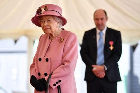 Britain's Queen Elizabeth II during a visit to the Defence Science and Technology Laboratory near Salisbury, southern England, on Oct. 15.PHOTO BY BEN STANSALL/Pool via AFP
